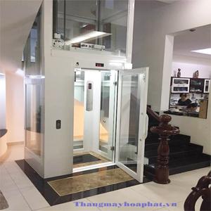 trang trí mặt tiền thang máy bằng kính